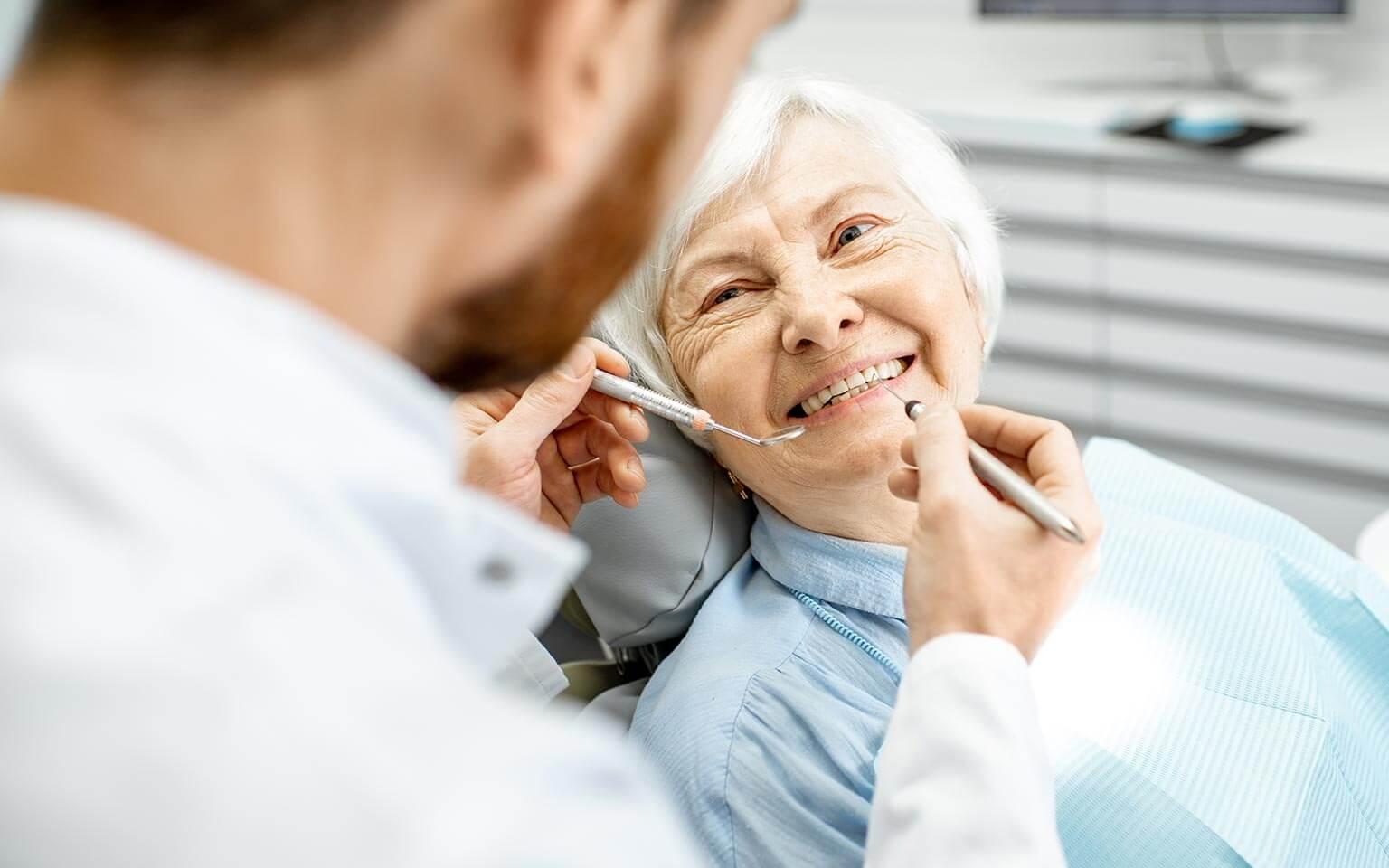 Elderly woman receiving treatment