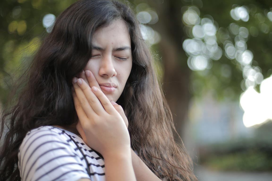 Girl with bad toothache